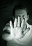 Stop. Monochromatic portrait of a man gesturing stop royalty free stock images