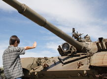 Stop!. Child mock stopping a tank, imitating a Chinese hero of Tienanmen Square Stock Photos