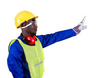 Stop. An african construction worker giving a stop sign signal with his hand on isolated white background Royalty Free Stock Photo