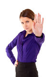 Stop!. Beautiful girl in business cloth with extended by hand on white background Royalty Free Stock Images