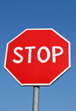 STOP. Sign infront of blue sky Royalty Free Stock Photography