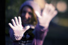 Stop. Girl with winter clothes show stop sign with her hands weared with gloves Stock Images