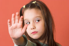 Stop!. Young girl holding a hand like a stop sign Stock Photo