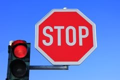 Stop. Sign and red light against a blue sky Stock Photography