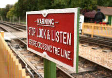 Stop. Railway crossing warning sign alongside track Stock Photos