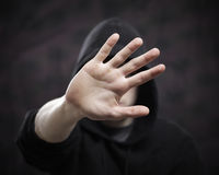 Stop. Boy hides his face with hand Royalty Free Stock Images