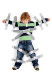 Stop. Young angry boy glued to the wall with duct tape Royalty Free Stock Photo