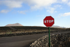 Stop. Road sign at the road intersection. Lanzarote, Spain Royalty Free Stock Image