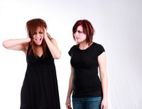 Stop it. 2 emo girls with messy hair and makeup fighting stock photos