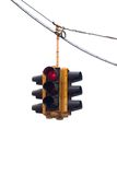 Stop!. Red traffic light hanging from a cable, isolated on white Stock Photo