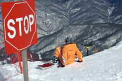 Stop. Snowboarder sitting under stop-sign. Red Field, Russia Stock Image