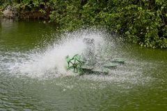 Stop action of water and aerator turbine in pool Stock Photography