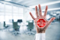 Stop administrative burden. Concept. Businessman hand with stop street sign and text Royalty Free Stock Image