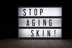 Stop aging skin!. `Stop aging skin` text in lightbox stock photo