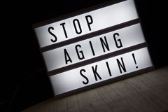 Stop aging skin. `Stop aging skin` text in lightbox royalty free stock photo