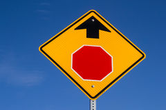 Stop ahead. The Stop Ahead sign with blue skies in background royalty free stock photo