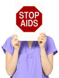 Stop AIDS. A medical person holding a modified stop sign on AIDS Stock Images