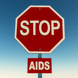 Stop aids. On stop sign over blue sky, concept of acquired immuno deficiency syndrome prevention Royalty Free Stock Image