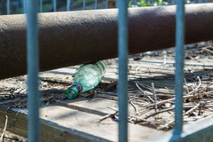 Stop alcoholism, metaphor. Old glass bottle abandoned on the ground Royalty Free Stock Photo