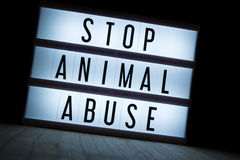 Stop animal abuse. `Stop animal abuse` text in lightbox royalty free stock image