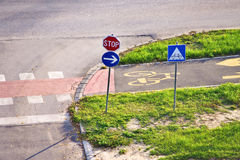 Stop, arrow and bicycle lane signs Stock Photography