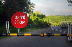 Stop barricade on railroad crossing, India Stock Photo