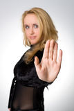 Stop. Blond woman holding hand up saying STOP royalty free stock photography