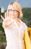 Stop!. Bright picture of young woman making stop gesture royalty free stock images