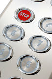 Stop button. Metal red stop button in the elevator Stock Photo