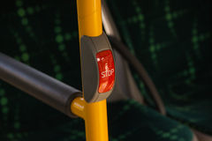 Stop button. The bus door opening button in public transport in Szczecin in Poland stock photo