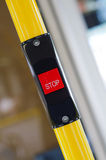 A stop button in the bus Stock Image