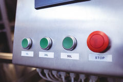Stop button on machinery at brewery Stock Photography