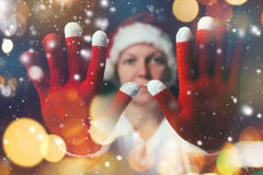 Stop the celebration, beautiful woman in Santa Claus costume Stock Photo