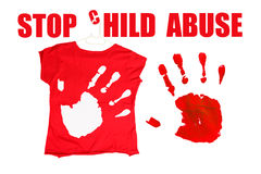 Stop child abuse. Red shirt with hand prints. Red hand print on white background and white hand print on red shirt royalty free stock photography