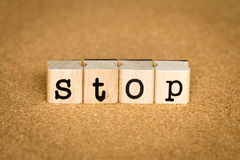 Stop Concept. Alphabet stamp on a cork board Royalty Free Stock Images