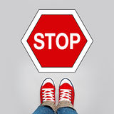 Stop Concept, Person Standing in Front of Sign Royalty Free Stock Photography