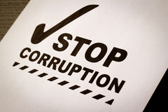 Stop corruption paper. Trop corruption in construction paper Royalty Free Stock Images