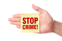 Stop Crime. Hand with Stop Crime note is isolated on white background Royalty Free Stock Photo