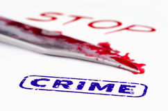 Stop crime stamped and knife close up. Royalty Free Stock Images