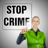 Stop crime. Young woman choosing Stop crime icon on virtual interface royalty free stock images