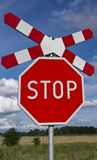 Stop and cross of St, Andrew Royalty Free Stock Photography