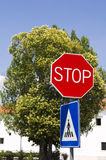 Stop and crosswalk road signs. In urban setting Stock Photo