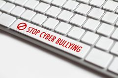 Stop cyber bullying words written on keyboard Royalty Free Stock Image