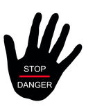 Stop danger. A hand cautioning you to stop because of danger Stock Photo