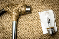 Stop destroy the future. A hammer stopped from destroying a lightbulb royalty free stock photos
