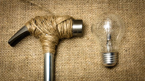 Stop destroy the future. A hammer stopped from destroying a lightbulb stock images