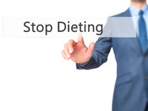 Stop Dieting - Businessman hand pressing button on touch screen royalty free stock photo