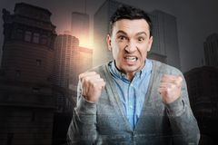Extremely angry millennial guy losing his temper Stock Photography
