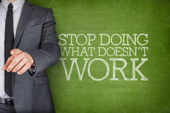 Stop doing what doesnt work on blackboard with businessman Stock Photography