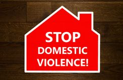 Stop domestic violence message. Over wooden background Stock Images